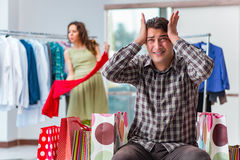 The man waiting for his wife during christmas shopping Stock Photography