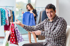 The man waiting for his wife during christmas shopping Stock Photo
