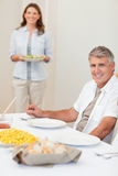 Man waiting for his wife to bring salad Stock Photo