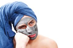 Man is waiting for the mask to dry on the skin, funny, man like a girl, photo royalty free stock images
