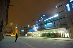Man waiting for a night bus in a snow storm. Tampere Train Station Stock Photos