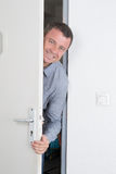 Man waiting for someone behind door Stock Photography