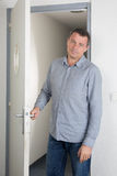 A man waiting for someone. At the door in a bright modern office a man waiting for someone royalty free stock image