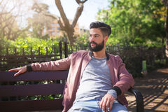 Man waiting for someone in the park Stock Photos
