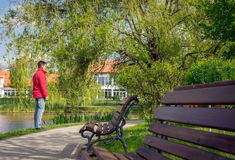Man waiting for someone in the park Royalty Free Stock Image