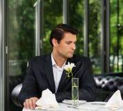 Man waiting someone in restaurant. Handsome man in jacket waiting someone in restaurant Stock Photos