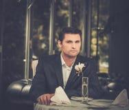Man waiting someone in restaurant. Handsome man in jacket waiting someone in restaurant Royalty Free Stock Image