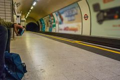 Man waiting for the subway in Leicester square station stock photo
