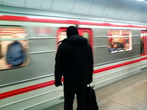 Man waiting for subway. Silhouette with moving train Stock Image