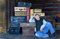 Man Waiting with Suitcases Royalty Free Stock Photography
