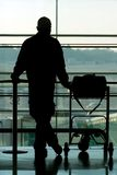 Man waiting at thel airport. Man waiting at the international airport terminal Royalty Free Stock Photos