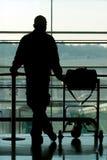 Man waiting at thel airport. Man waiting at the international airport terminal royalty free stock photos