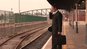 Man waiting for train Royalty Free Stock Photo
