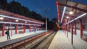 Man Waiting on Train Platform during Nighttime Royalty Free Stock Photos