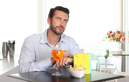 Man waiting for woman late to date Stock Image
