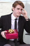 Man waitning with gift in his hand Royalty Free Stock Images