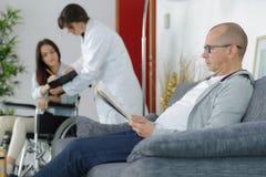 Man waits for doctor Stock Photos