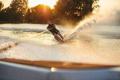Man wakeboarding on lake behind boat Royalty Free Stock Photography