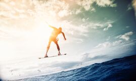 Man Wakeboarding over Body of Water Stock Photos