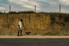 Man waking in the roadway. Photography taken in the Bahia state of Brazil Royalty Free Stock Images