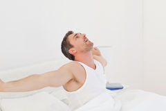 A man  waking up. A man waking up in his bedroom Stock Photo
