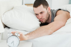 Man waking up Stock Images