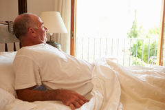 Man Waking Up In Bed In Morning Royalty Free Stock Image