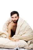 Man waking up in bed. Royalty Free Stock Photos