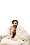 Man waking up in bed. Stock Photo