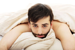 Man waking up in bedroom. Stock Photos