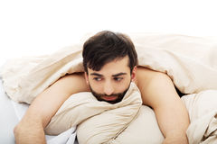 Man waking up in bedroom. Royalty Free Stock Photography