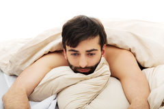 Man waking up in bedroom. Royalty Free Stock Photos