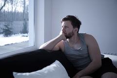 Man waking up early Stock Images