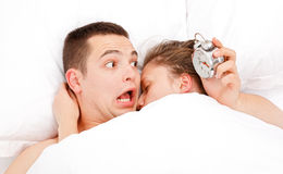 Man waking up lately Stock Photography
