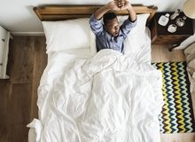 Man waking up in the morning Stock Images