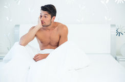 Man waking up in the morning. Portrait of a handsome man waking up in the morning at home Stock Photo