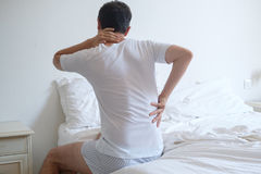 Man waking up in the morning and suffering because of backache Royalty Free Stock Image