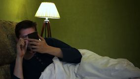 Man waking up for reading message in a smartphone. stock video