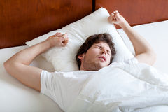 Man waking up softly Royalty Free Stock Image