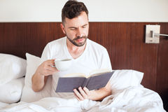 Man waking up with some coffee Royalty Free Stock Image