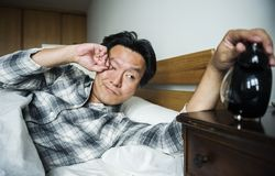 A man waking up to the alarm Royalty Free Stock Photography