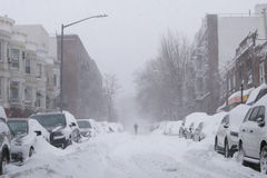 Man walk along snow covered street Royalty Free Stock Photography