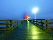 Man walk in autumn mist on wooden pier above sea. Depression, dark  atmosphere. Man ghost walk in autumn mist on wooden pier above sea. Depression, dark Stock Photos