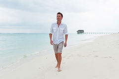 Man walk on the beautiful beach Royalty Free Stock Photo
