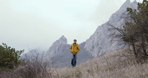 Man walk from rocks and mountains. stock video footage