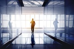 Man walk and speak by mobile phone office hall stock images