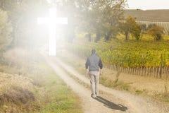 Man walk to the Cross. Man walking to a Christian Cross of light royalty free stock photos