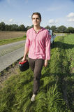 Man walk to the gas station Stock Photography
