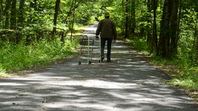 Man with Walker. On country road