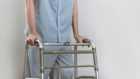 Man with walker Royalty Free Stock Photo
